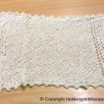Heklet og strikket hvitt babyteppe