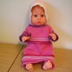 Baby born dukkeklær: Strikket rosa kjole